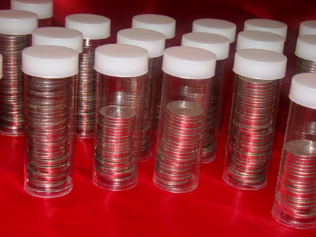 us coin: stacks of coins in tubes