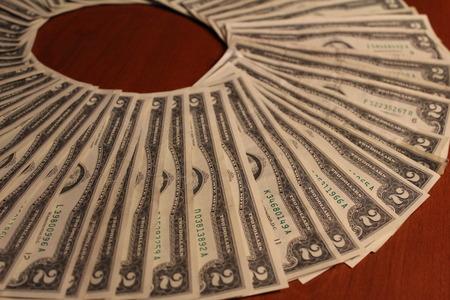Circle of two dollar bills Imagens