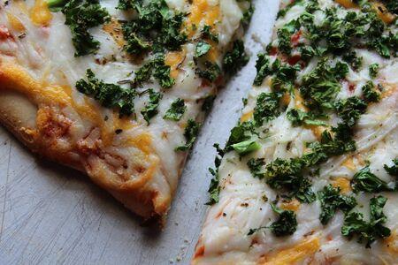 heart heat: Fresh Kale on freshly made Pizza Stock Photo