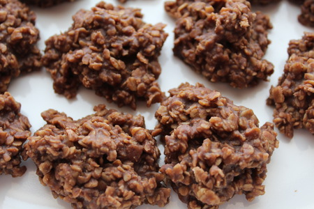 chocolate oatmeal drop cookies also called preacher cookies, and no bake cookies on a tray.