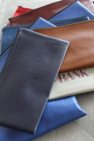 deposit slip: Group of multi colored financial banking bags