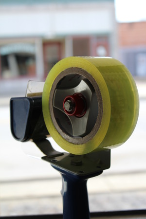 sealing tape: Tape Dispenser for sealing shipping boxes.