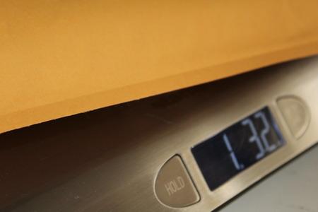 meter box: bubble envelope on scales Stock Photo