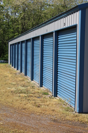 A row of public self storage units on a sunny day Stock Photo