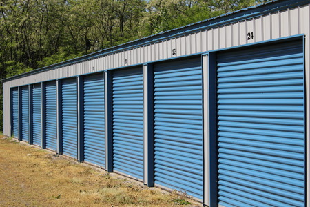 self storage: A row of public self storage units on a sunny day Stock Photo