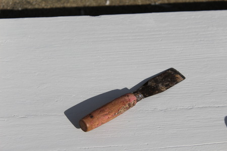 Used Putty knife for scraping old paint