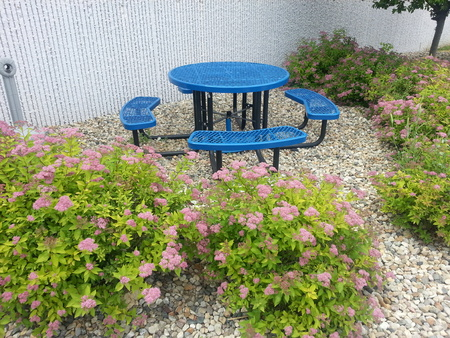 outdoor Employee smoking and break area that is well kept Stock Photo