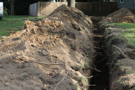 Home lawn trench, excavation,  putting in a new residential  water line