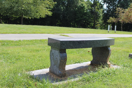 Marble gravestone bench in a cemetery