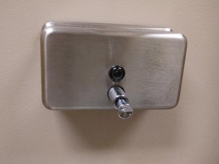 Stainless steel Public bathroom Soap dispenser Stock Photo