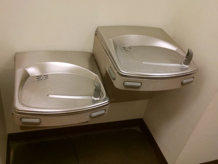 Indoor Modern drinking fountains - one for adults and one for children.