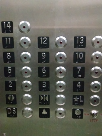 Close up of elevator floor buttons