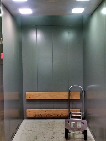 Service elevator for large office building. Stock Photo