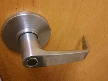 Close up of a public restroom door handle