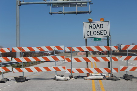 road closed: Road Closed barricades for through traffic over bridge.