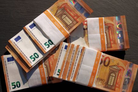 Cash in banknotes, 50 euro banknotes bundled for cash payment