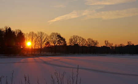 sunrise over a frozen lake, the sun provides a special light