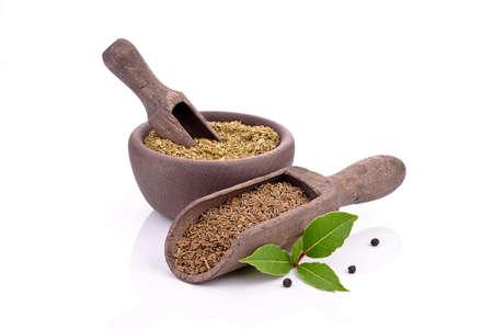 cumin: Cumin seeds with minced marjoram Stock Photo