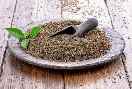 cumin: Cumin seeds on a wooden plate