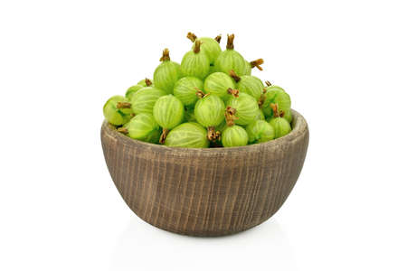 Gooseberries in a wooden bowl