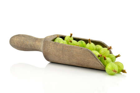 Gooseberries on a wooden spoon