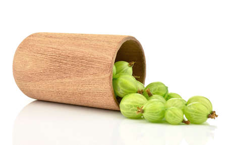 Gooseberries with a wooden mug on a white background Stock Photo