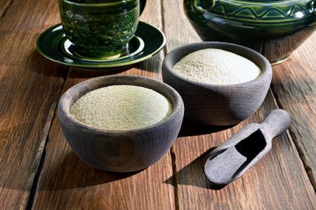 Couscous in wooden bowls
