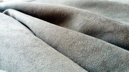The fabric is gray velvet laid by the waves. Close-up. Lighting is natural. Gray, blue, brown Stockfoto