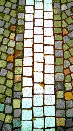 Mosaic of natural stones on a bridge street in an old European city.