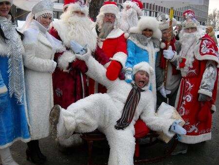 Petrozavodsk, Republic of Karelia / Russia - November 9, 2019: people in suits of Santa Claus, the Snow Maiden and the polar bear are fooling around and having fun. Polar bear lay down.