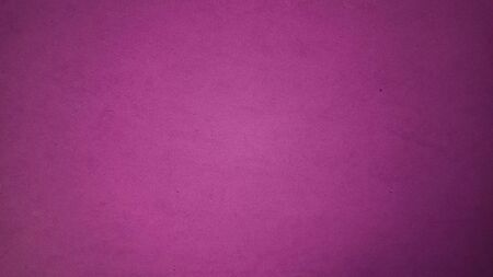 A sheet of bright purple paper with light vignetting around the edges. Passionate lilac color. Saturated bright paint. Velvet paper texture. Background for greeting card or page. Valentines Day.