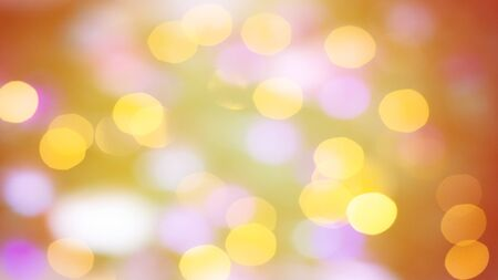 Festive warm background or greeting card. Sun glare on an orange background. The nuances of orange, yellow, pink and white. Bokeh effect.
