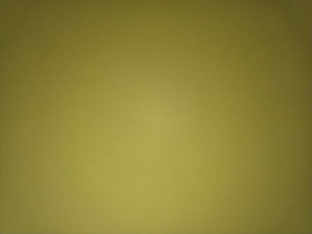 A sheet of pale yellow paper with vignetting around the edges. Dirty yellow color.