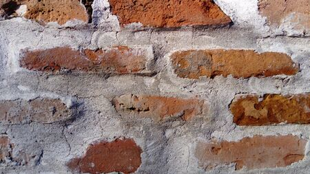 Old roman brick. The restored wall of the building of the Roman conquerors. Warm brown-red shades of uneven bricks. Archaeological site in the city of Sremska Mitrovica, Serbia Stock fotó - 138162670