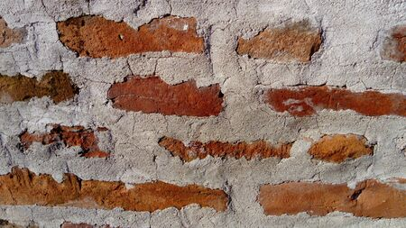 Old roman brick. The restored wall of the building of the Roman conquerors. Warm brown-red shades of uneven bricks. Archaeological site in the city of Sremska Mitrovica, Serbia Stock fotó - 138162674