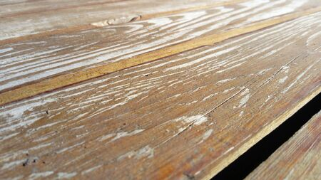 Wood texture. A wooden bench. Cracks on the log. Product from the boards. Fresh light wood. Zdjęcie Seryjne