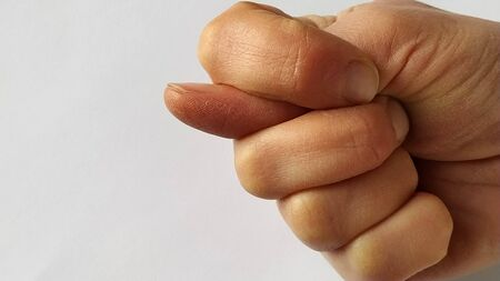 It's a fig. A fist with a thumb stuck between the index and middle. A rude gesture indicating mockery, contempt, and a desire to humiliate an opponent. Failure in a rude manner.