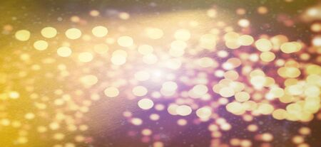 Mysterious abstract warm background or greeting card. Sun glare on a bright yellow background. The nuances of orange, yellow, pink, purple, beige and white. Beautiful bokeh effect