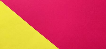 A yellow sheet of paper is laid sideways on a red sheet of paper. Thick paper or thin cardboard. The yellow element is on the left and the red is on the right.