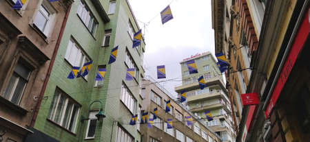 Sarajevo, Bosnia and Herzegovina, March 8, 2020. Streets decorated with national flags of Sarajevo. Ancient buildings in the city center. Tourist area with shops, exhibitions, cafes and restaurants. Editorial