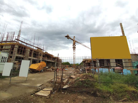 Sremska Mitrovica, Serbia. June 10, 2020. Construction of an apartment building under the state program for refugees, police and military personnel. Billboards, building materials and crane.