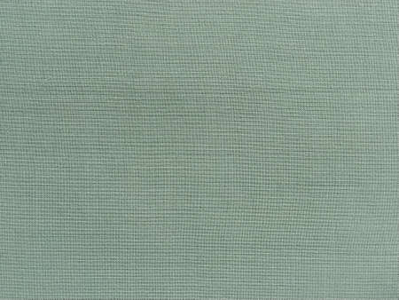 light green fabric. A piece of woolen fabric laid out neatly on the surface. Interlacing and textile texture. dress fabric or for kitchen needs, tablecloth or curtains.