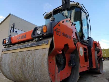 Compactor - Heavy Vibration roller for asphalt works and road repair. Road roller. Excavation, construction, asphalt paving works. Modern construction equipment. Belgrade, Serbia, October 18, 2020.