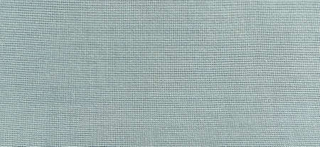 blue-green background of intertwined threads and rows. Banner. Fabric texture with uneven surface.