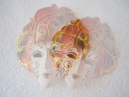 Carnival masks on a white background. Carnival festival costume element. Pastel, gentle and hazy atmosphere. Collage and double exposure. Italian and Venetian tradition