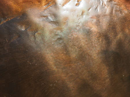 Metal bronze textured plate. Bronze or copper polished surface with dents, scratches and indentations. Metal texture.