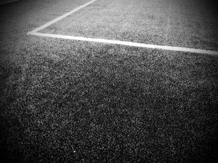The marking of the football field. White lines no more than 12 cm or 5 inches wide. Football field area. Black and white monochrome photography.