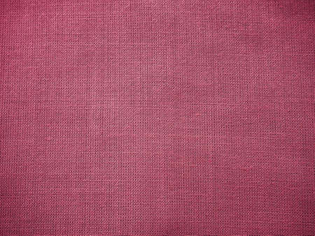 Cloth close-up. Interlacing of threads. A piece of pink fabric. Fabric background. Copy space. Stock fotó