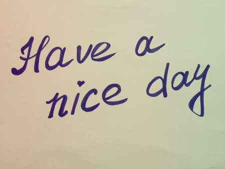 Have a nice day. Phrase or lettering. Black handwritten words. Multicolored background in retro or vintage style. Background burnt out in the light. Good day wishes or goodbye greetings. Postcard.
