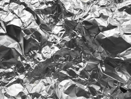 foil close-up. Aluminum silver crumpled foil. Abstract metallic background. Foil for baking food. Background.